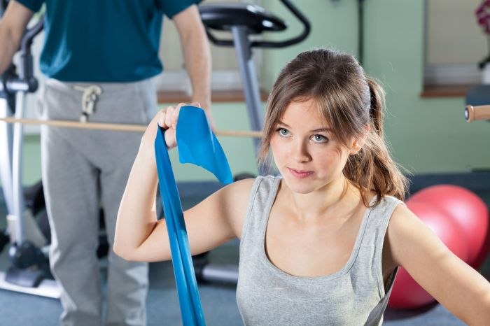 29593815 - beautiful girl exercising at physiotherapy clinic, horizontal