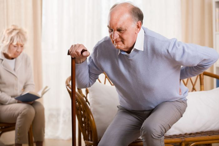 39944197 - retired man using walking stick having backache